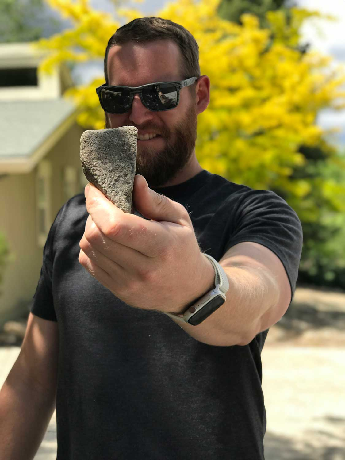 E. Peterson with rock found in Topaz, California.